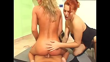 sandy-haired and blond damsel on floor fellates and.