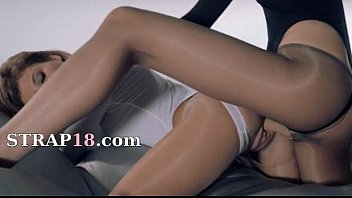 gals in stocking penetrating with strap.