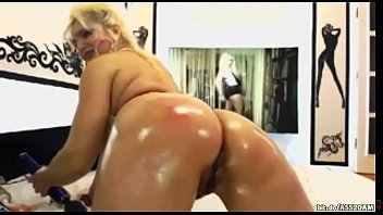 steaming blond cougar having joy with her pummel.