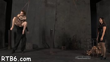 manacled darling gets painful whipping on her thin bod