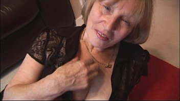large-chested blond grandmother rips stocking to display off.