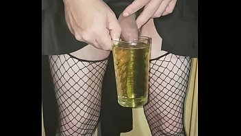crossdressing sissy drinks his own urinate and swollows.