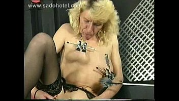 german sub with metal clothespins on her labia.