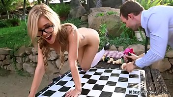 silver-blonde nubile smashed on chess table