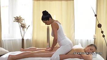 chesty masseuse gives lesbo face sitting