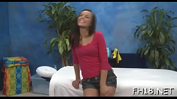 longhaired nymph kneels and deepthroats pecker of trendy man