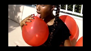 goddess jasmine plays with balloons outside