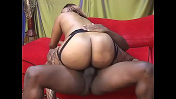 immense ebony bum in fishnets bounces her cunt.