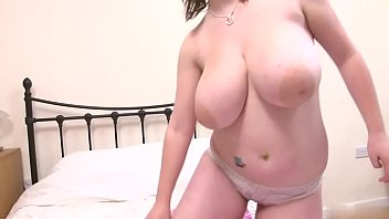 dd dark-haired flashses her huge milk cans in.