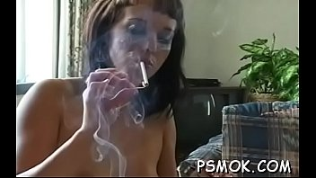 ginormous-chested sweetie liking a guzzle and a smoke.